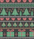 Christmas, holiday drawing. Trees, gifts and hearts. Seamless decorative background. Jacquard weave. Knitted pattern. royalty free stock photo