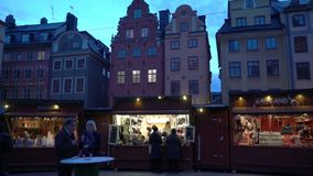 Christmas holiday fair at the Big Square Stortorget in the Old Town Gamla Stan, Stockholm stock footage
