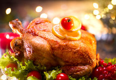 Christmas holiday family dinner. Decorated table with roasted turkey. Christmas tree stock photo