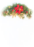Christmas holiday faux poinsettia pine wreath with white copyspace. Royalty Free Stock Photography