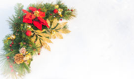 Christmas holiday faux poinsettia pine wreath with white copyspace. Royalty Free Stock Image