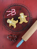 Christmas holiday festive baking with gingerbread men cookies Royalty Free Stock Photos