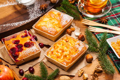Christmas Holiday Fruit Cakes. The assortment of Christmas Holiday Fruit Apricot, Apple and Cranberry Cakes. Selective focus royalty free stock images