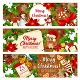 Christmas holiday gift banner on wooden background. Christmas holiday greeting banner with New Year gift on wooden background. Snowman with Xmas present, holly Stock Photography