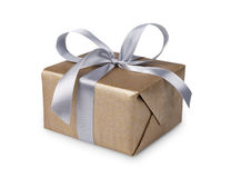 Christmas holiday gift box in golden paper isolated on white Royalty Free Stock Image