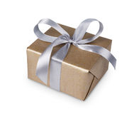 Christmas holiday gift box in golden paper isolated on white Stock Photos
