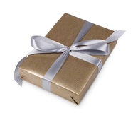 Christmas holiday gift box in golden paper isolated on white Royalty Free Stock Images