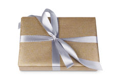 Christmas holiday gift box in golden paper isolated on white Stock Images