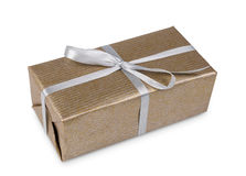 Christmas holiday gift box in golden paper  on white Stock Images