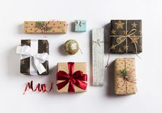 Christmas holiday gift box new year on white background. Packaging gift wrap and ribbons, twine. Winter time new year Royalty Free Stock Photos