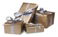 Christmas holiday gift boxes in golden paper isolated on white Royalty Free Stock Photos