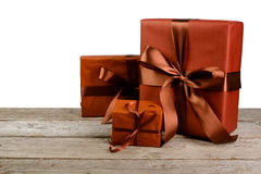 Christmas holiday gift boxes in paper  on white Stock Photo