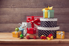 Christmas holiday gift boxes on wooden table Stock Images