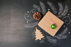 Christmas holiday gift on chalkboard background. View from above with copy space. Christmas holiday gift on chalkboard background. View from above stock photo
