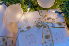 Christmas Holiday Gifts beautifully wrapped in white and gold ri Stock Photo