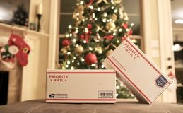 USPS Priority Mail Christmas Holiday Gifts. Christmas Holiday Gifts that have been delivered via United States Postal Service Priority Mail Stock Photography