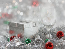 Christmas holiday. Glasses, presents, silver bells, and holiday decorations with a beautiful blurred bokeh background royalty free stock images