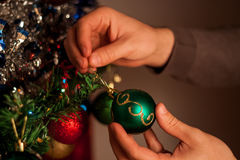 Christmas holiday green and red decoration. Guy& x27;s hands ornament Stock Photography