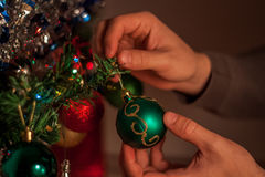 Christmas holiday green and red decoration. Guy& x27;s hands ornament Stock Image