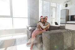 Christmas Holiday Happy Couple Sitting On Couch Modern Apartment With Panoramic Window Stock Image