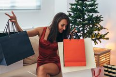 Christmas holiday happy woman with shopping bags at home. New Year.  royalty free stock photography