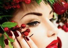 Christmas holiday makeup. Beauty woman face closeup Stock Photo