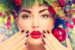 Christmas holiday makeup and manicure. Closeup Stock Images