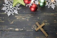 Christmas Holiday Ornaments and Christian Cross on a Dark Wood B. Christmas holiday ornaments and a Christian cross on a dark vintage wood background Stock Photography
