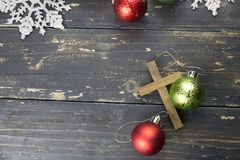 Christmas Holiday Ornaments and Christian Cross on a Dark Wood B. Christmas holiday ornaments and a Christian cross on a dark vintage wood background Stock Images