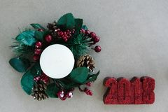 Christmas holiday ornaments on rustic background royalty free stock images