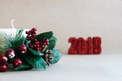 Christmas holiday ornaments on rustic background royalty free stock photography