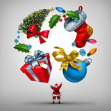 Christmas Holiday Planning. And organizing new year celebrations as santa clause juggling a group of  yuletide items as a gift and tree with winter festive Stock Image