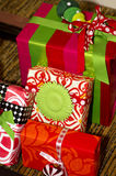 Christmas Holiday Presents. Wrapped Christmas gifts sit below an artificial Christmas tree Royalty Free Stock Photos