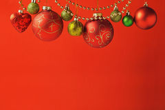 Christmas holiday red background with ornaments Stock Photos