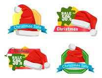 Christmas Holiday Sale Badges Vector Illustration. Set of Christmas holiday sale badges or stickers with Santa Claus hat and lettering on colourful tags stock illustration