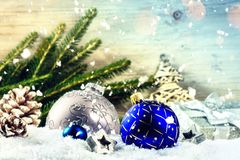 Christmas holiday setting with blue baubles and pine cones over Royalty Free Stock Photos