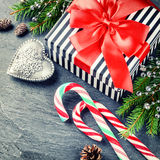 Christmas holiday setting with gift box and candy canes Stock Image