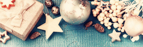 Christmas holiday setting with present and festive decorations i Stock Image