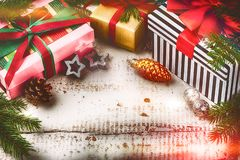 Christmas holiday setting with presents in boxes and festive dec stock images