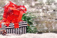 Christmas holiday setting with presents in boxes over snow stock photo
