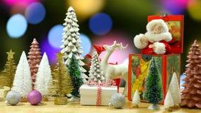Christmas holiday setting with vintage Santa music box and ornaments. Christmas holiday table with vintage Santa jack in the box and Christmas tree and reindeer royalty free stock photos