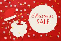 Christmas holiday shopping concept. Santa claus red and beard hat on red wooden background Stock Photography