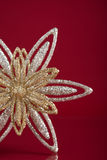 Christmas holiday snowflake on dark red background with copy space Stock Photos