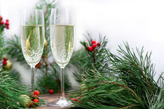 Christmas holiday still-life of with champaign, pine branches, r. Christmas and New Year seasonal composition with pine tree branches, two glasses of champaign stock images