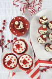 Christmas holiday Strawberry Santas with cherry red velvet cupcakes Stock Photos