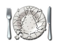 Christmas Holiday Stress. Concept as a broken dinner plate shaped as an xmas tree as a symbol of feeling stressed during the festive party season and the Stock Photos