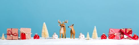 Christmas holiday theme with reindeer. And Christmas trees Stock Photo