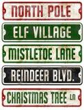 Christmas Holiday Theme Street Signs Collection. Elf Mistletoe lane reindeer Rudolf North Pole Santa stock photography