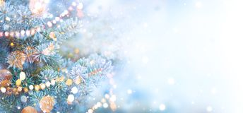 Christmas holiday tree decorated with garland lights. Border snow background. Snowflakes. Blue spruce, beautiful Christmas and New Year Xmas tree art design royalty free stock images