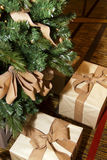 Christmas Holiday Tree Presents. Wrapped Christmas gifts sit below an artificial Christmas tree Stock Image